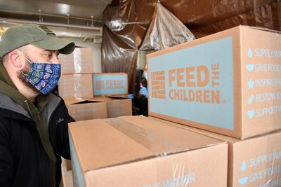 Light of Life Rescue Mission volunteers in Pittsburgh, Penn. distributing boxes of food and essentials from Feed the Children to hundreds of local families.