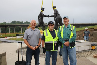 Aim Co-President Scott Fleming (left) and employees Cliff Dilling and Bob Thibodeau watched the placement of the Robinson-Shuba statue after Bob, Cliff and an Aim colleague, Scott Harris (not pictured), delivered the statue safely from the casting foundry in Brooklyn, N.Y.