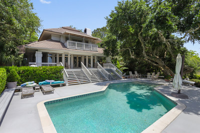 With sweeping views of Hilton Head Island's majestic marshes and wildlife, a private dock for kayaking and boating, and an elevated, landscaped breezeway that connects a guest house to the main house, the fabulous home at 29 Baynard Park Road is a rare find today in the exclusive Sea Pines community.