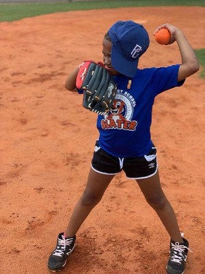 A grant from the Perfect Game Cares Foundation's Grow the Game Fund is providing baseball and softball playing opportunities for Atlanta-area students, including this young girl from Slater Elementary School.