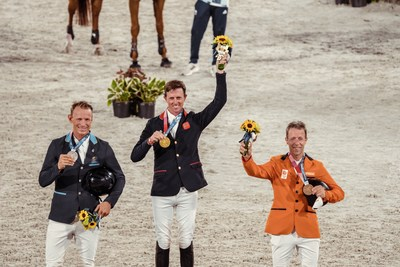 Great Britain's Ben Maher celebrates his gold medal win in the Individual Showjumping Final at the Tokyo 2020 Olympic Games at the Baji Koen Equestrian Park. L to R: Peder Fredricson (SWE), Ben Maher (GBR), Maikel van der Vleuten (NED) (FEI/Christophe Taniere) (PRNewsfoto/FEI)